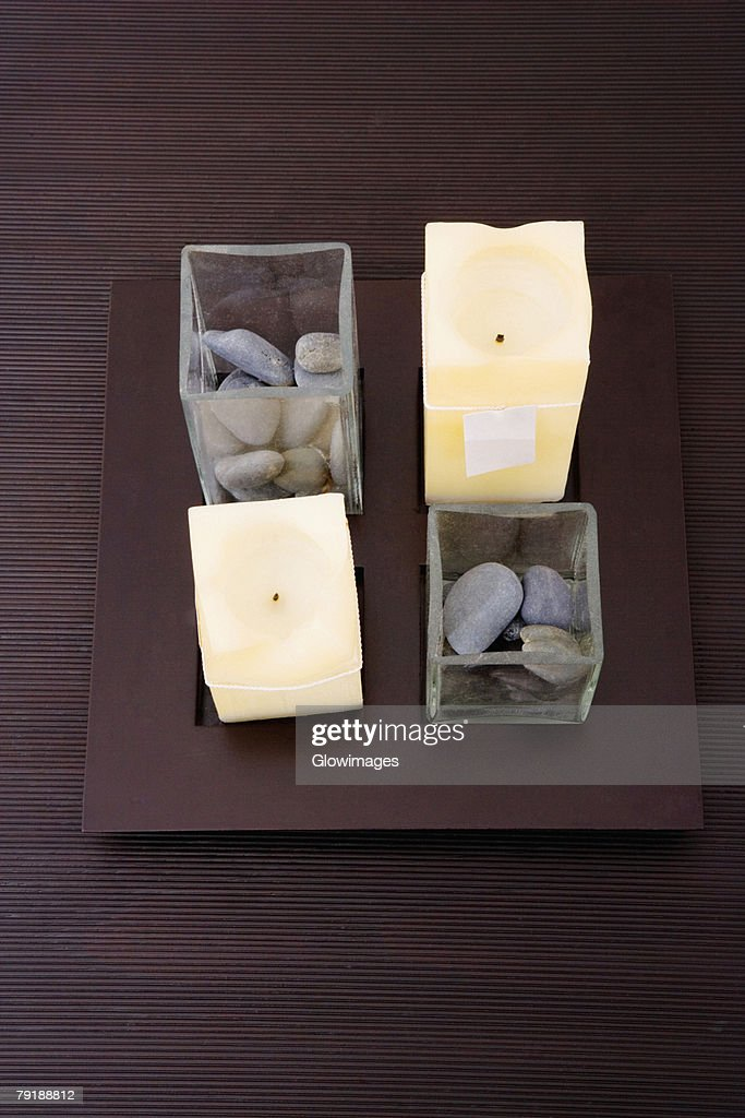 High angle view of candles and pebbles on a table : Stock Photo