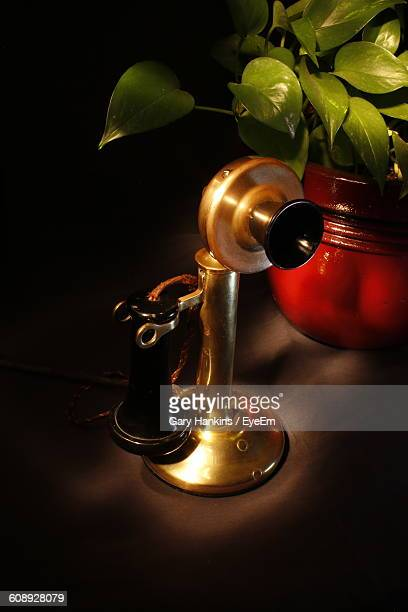 High Angle View Of Candlestick Phone On Table