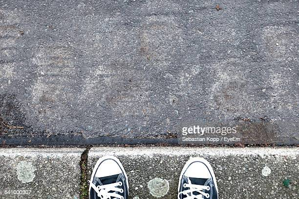 High Angle View Of Canvas Shoe On Sidewalk