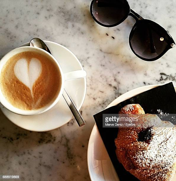 High Angle View Of Cappuccino And Pastry