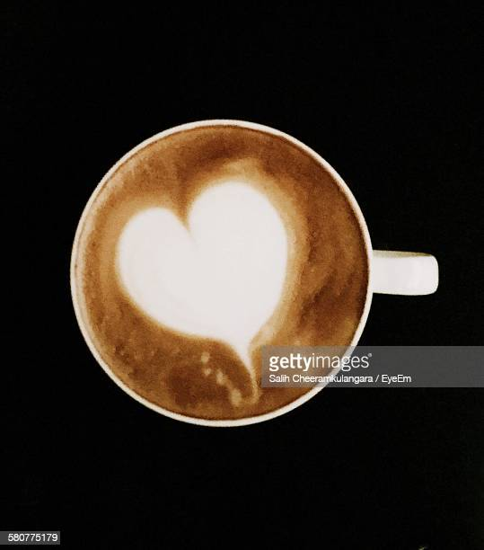 High Angle View Of Cappuccino In Cup Against Black Background