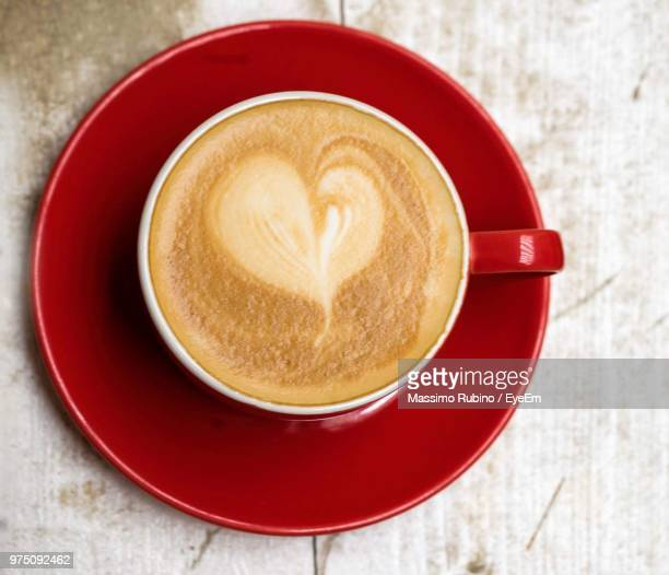 high angle view of cappuccino on table - saucer stock pictures, royalty-free photos & images