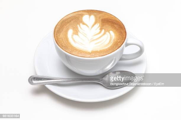high angle view of cappuccino on white background - cappuccino stock pictures, royalty-free photos & images