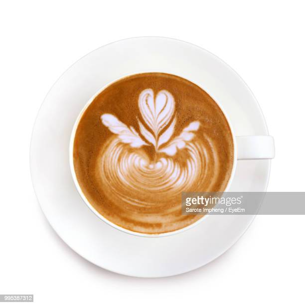 high angle view of cappuccino on white background - latte stock pictures, royalty-free photos & images