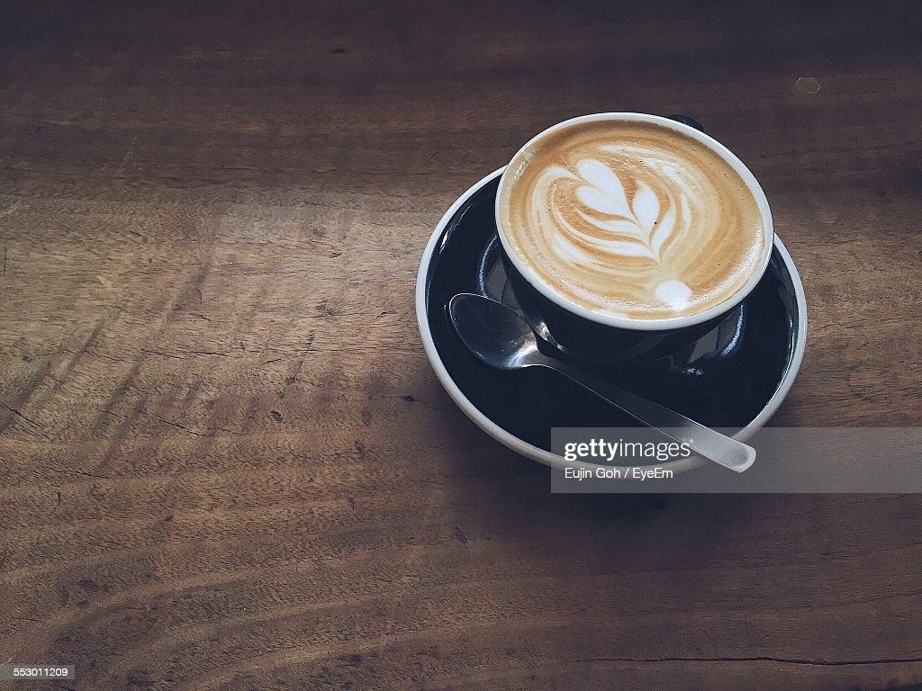 High Angle View Of Cappuccino On Wooden Table : Stock-Foto