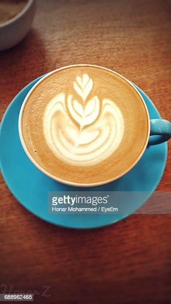 High Angle View Of Cappuccino Served On Table In Cafe