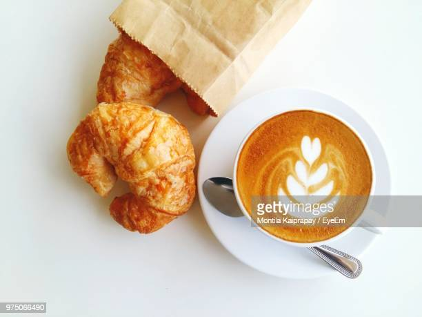 high angle view of cappuccino with croissant on white background - baked pastry item stock pictures, royalty-free photos & images