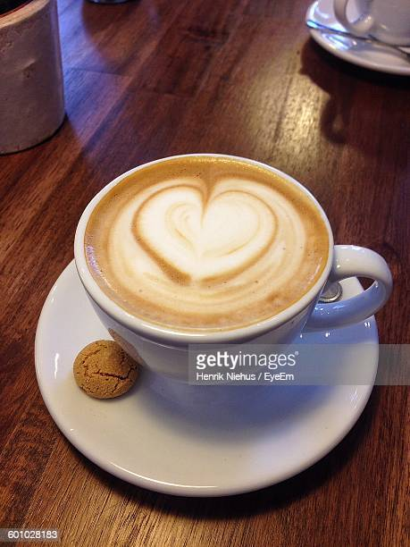 High Angle View Of Cappuccino With Heart Shape Froth Art