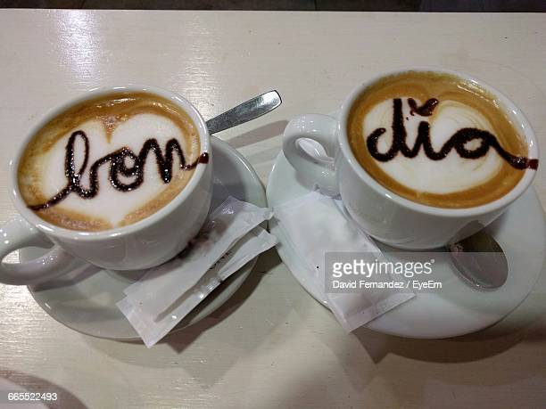 High Angle View Of Cappuccinos With Text On Table
