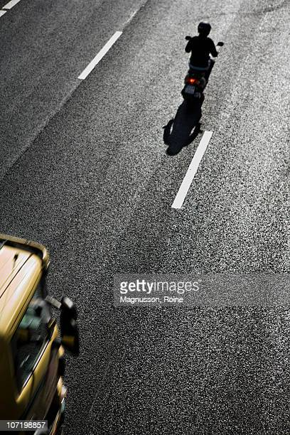 High angle view of car and motorcycle on road
