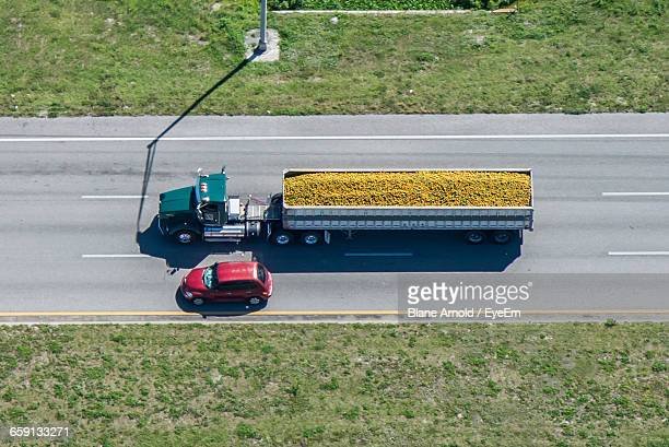 High Angle View Of Car And Truck On Road