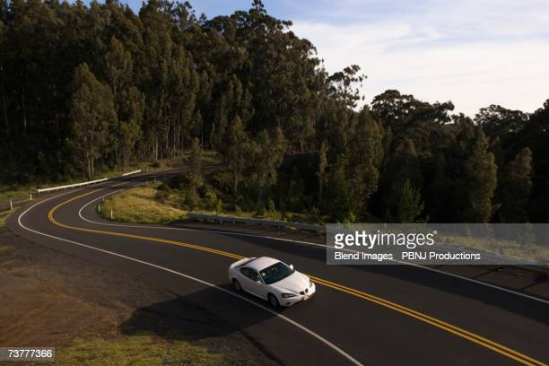High angle view of car driving on winding road