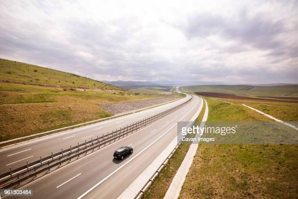 high angle view of car on highway against sky - two lane highway stock pictures, royalty-free photos & images