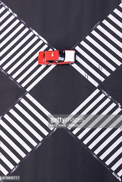 High Angle View Of Car On Intersecting Pedestrian Crossings
