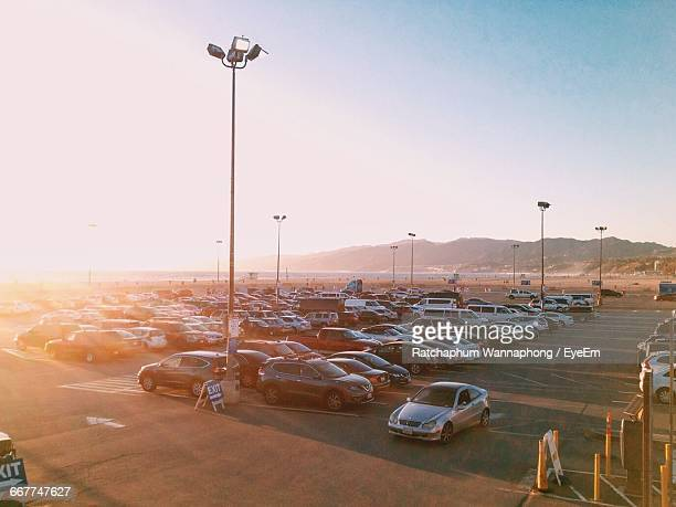 High Angle View Of Car Park Against Clear Sky