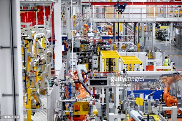 high angle view of car production line - incidental people stock pictures, royalty-free photos & images