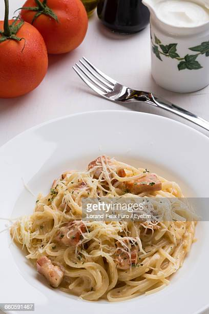 High Angle View Of Carbonara In Plate On Table