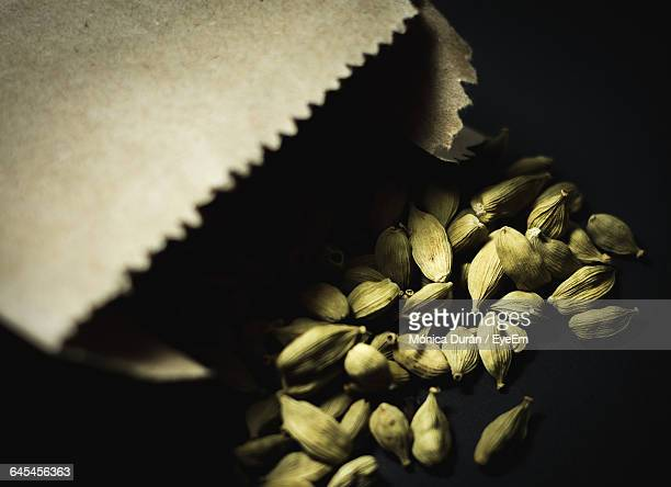 High Angle View Of Cardamom Against Black Background
