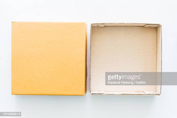 high angle view of cardboard box over white background - cardboard box stock pictures, royalty-free photos & images