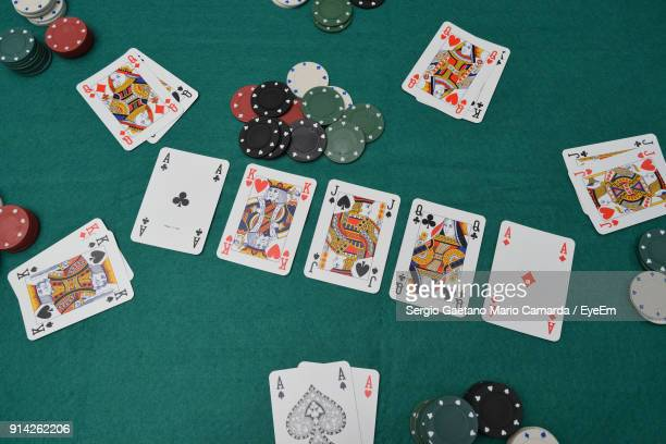 High Angle View Of Cards With Gambling Chips On Table