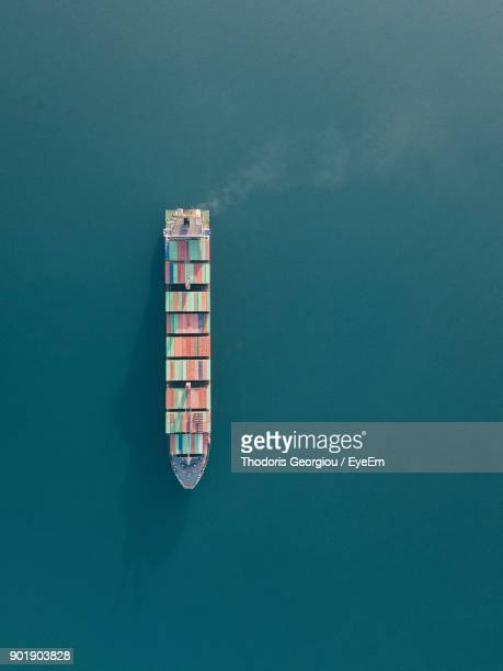 high angle view of cargo ship on sea - cargo ship stock pictures, royalty-free photos & images