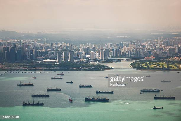 High Angle View Of Cargo Ships with Singapore Marina Bay