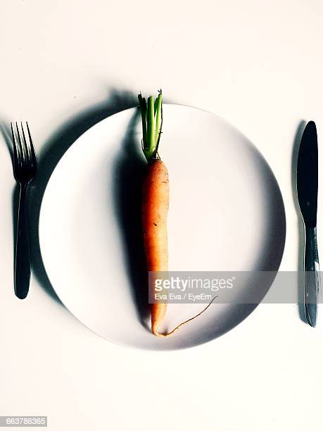 High Angle View Of Carrot In Plate On White Background