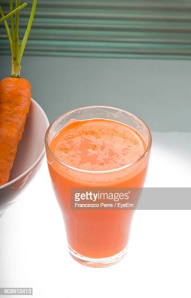High Angle View Of Carrot Juice In Glass On Table