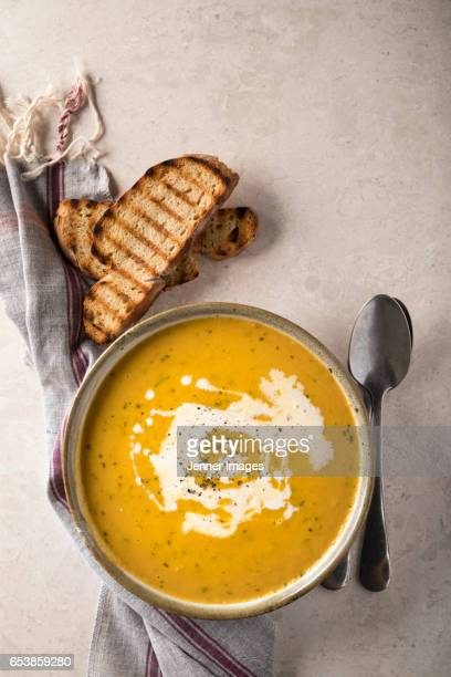 high angle view of carrot soup with coriander. - soup stock pictures, royalty-free photos & images