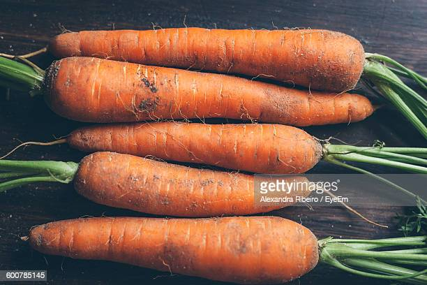 high angle view of carrots on table - carrot stock pictures, royalty-free photos & images
