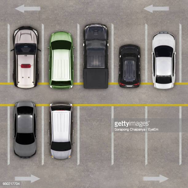 high angle view of cars in parking lot - car park stock pictures, royalty-free photos & images