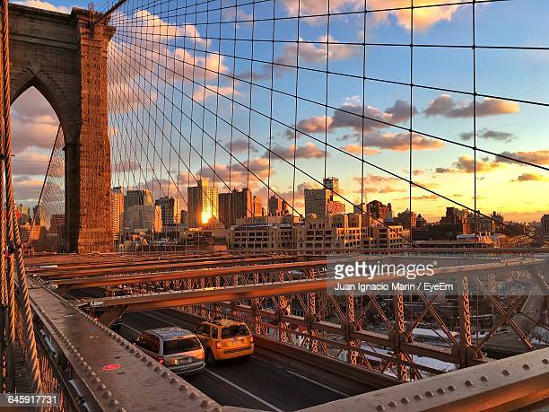 High Angle View Of Cars On Brooklyn Bridge In City At Sunset