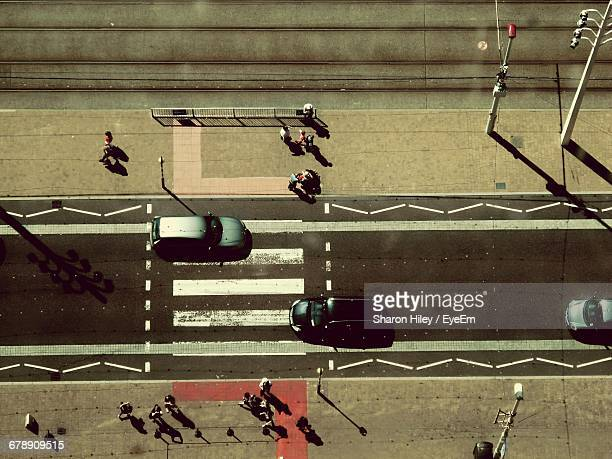 high angle view of cars on road amidst people walking in city - blackpool stock pictures, royalty-free photos & images