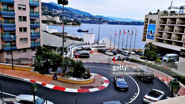 high angle view of cars on road by sea against sky - monaco stock-fotos und bilder