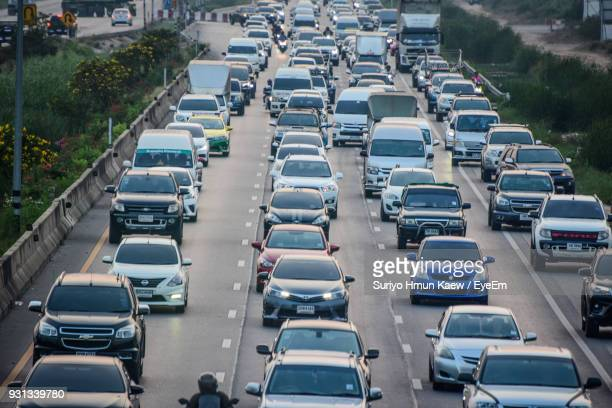high angle view of cars on street in city - traffic jam stock pictures, royalty-free photos & images