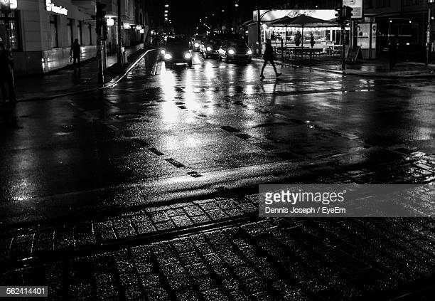 High Angle View Of Cars On Wet Street At Night