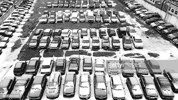 High Angle View Of Cars Parked In Parking Lot During Winter