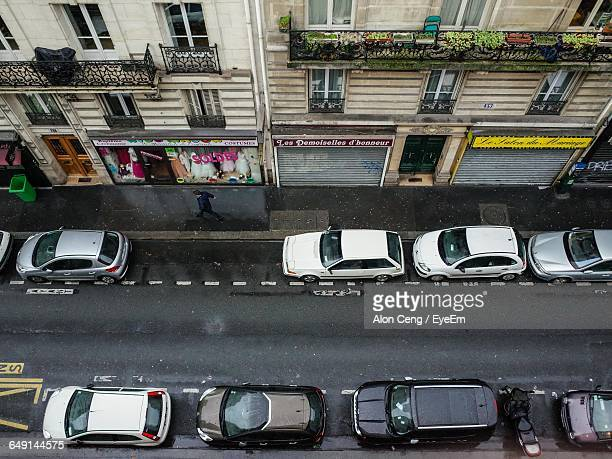 High Angle View Of Cars Parked On Street Amidst Buildings