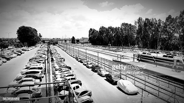 high angle view of cars parked outside railroad station - 列車の車両 ストックフォトと画像