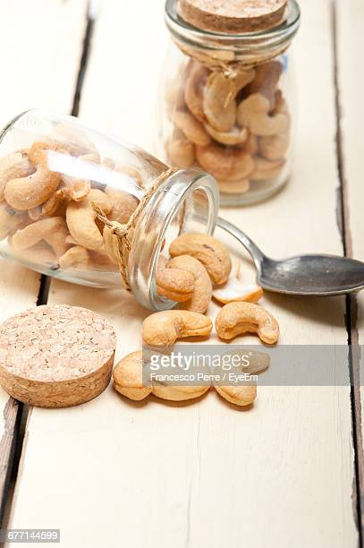 High Angle View Of Cashews In Jars On Table