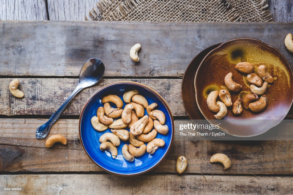 High Angle View Of Cashews On Table : Stock Photo
