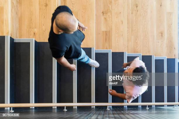 high angle view of casually dressed business people on stairs - moving past stock photos and pictures