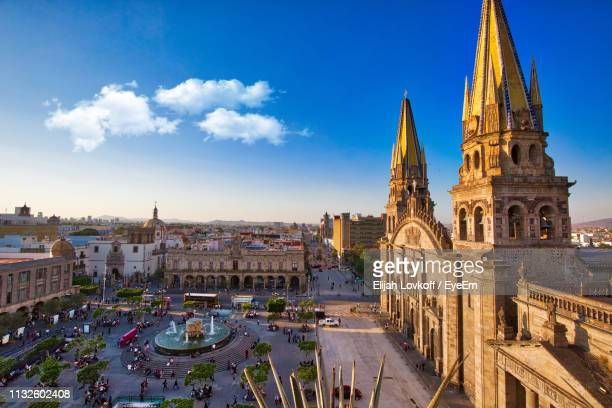 high angle view of cathedral against blue sky in city - mexiko stock-fotos und bilder