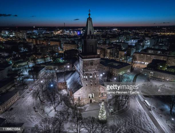 high angle view of cathedral at night in city - トゥルク ストックフォトと画像