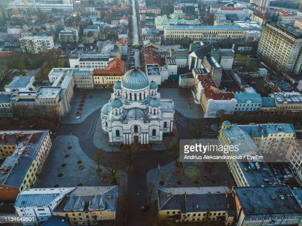 high angle view of cathedral surrounded by cityscape - lithuania stock pictures, royalty-free photos & images