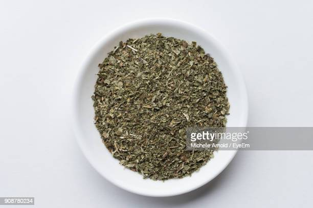 high angle view of catnip in bowl over white background - catmint stock pictures, royalty-free photos & images