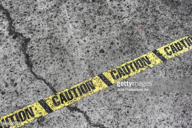 High angle view of caution tape on pavement
