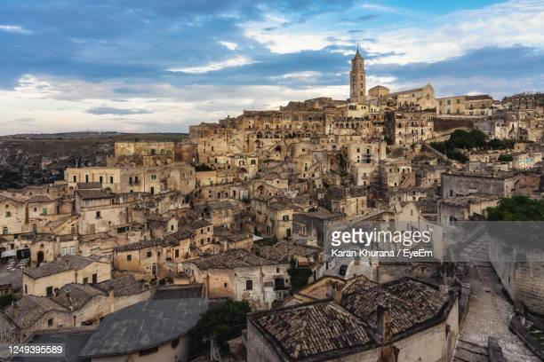 high angle view of cave dwellings known as sassi on a hill in the town of matera in italy - マテーラ ストックフォトと画像