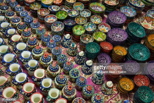 high angle view of ceramics for sale at street market - shaifulzamri stock pictures, royalty-free photos & images