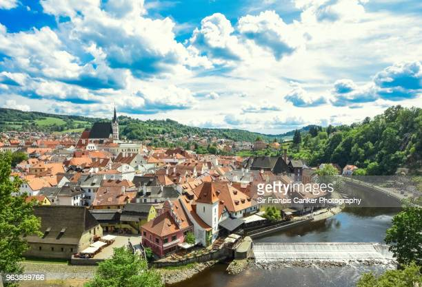 high angle view of cesky krumlov skyline on a sunny day with romantic sky and waterfall in czech republic, a unesco heritage site - townscape stock pictures, royalty-free photos & images